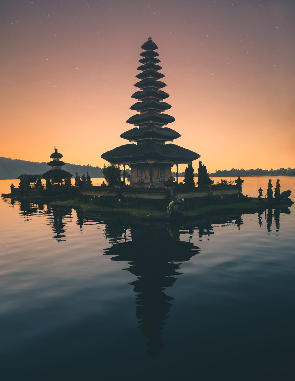 brown pagoda near body of water